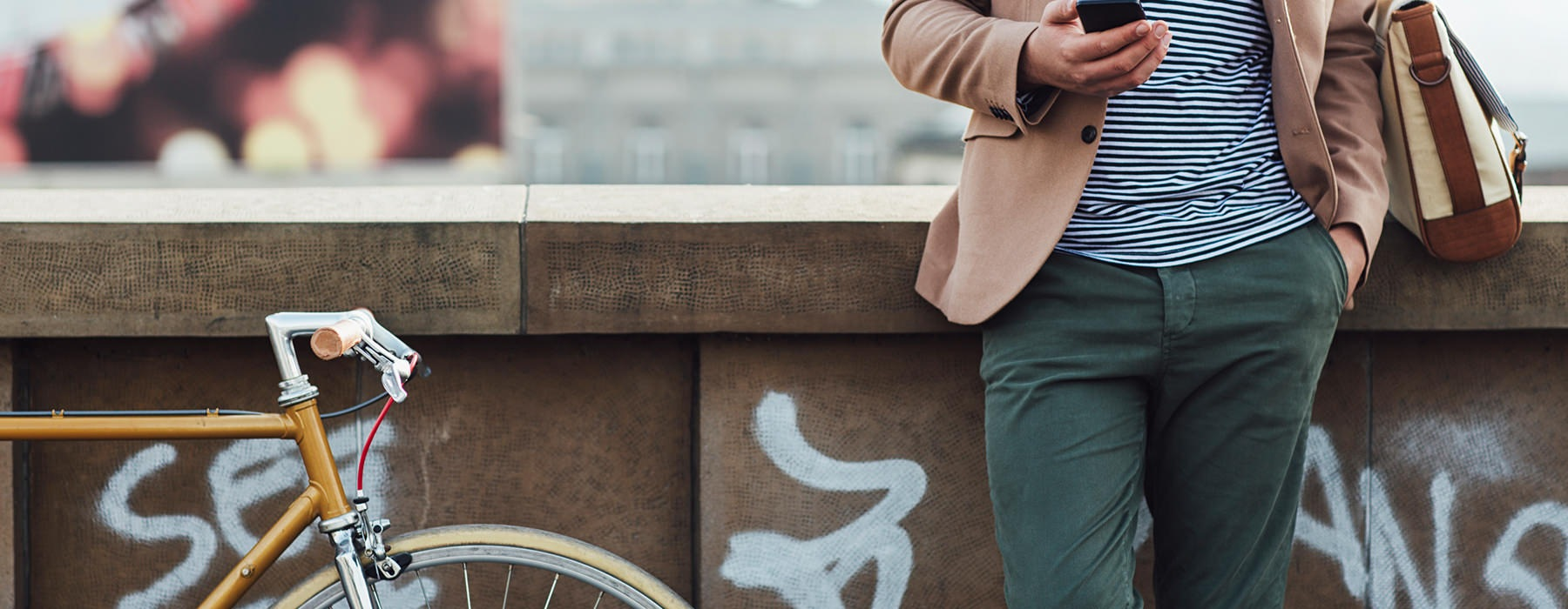 lifestyle image of a man beside his bicycle